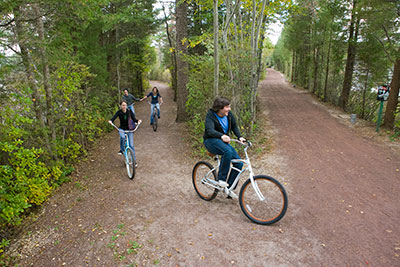students riding bikes down a path