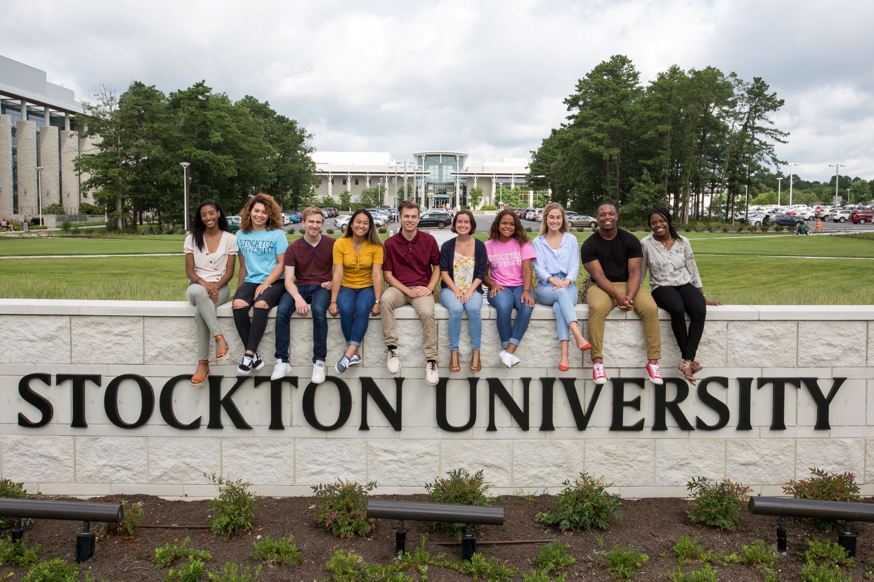 stockton univeristy students on sign