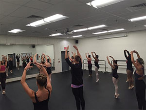 Dancers in class in M205
