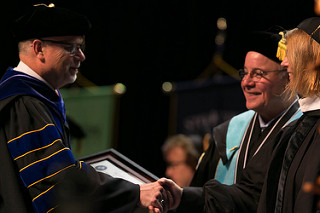 Dr. Carr shaking hands with Dr. Kesselman