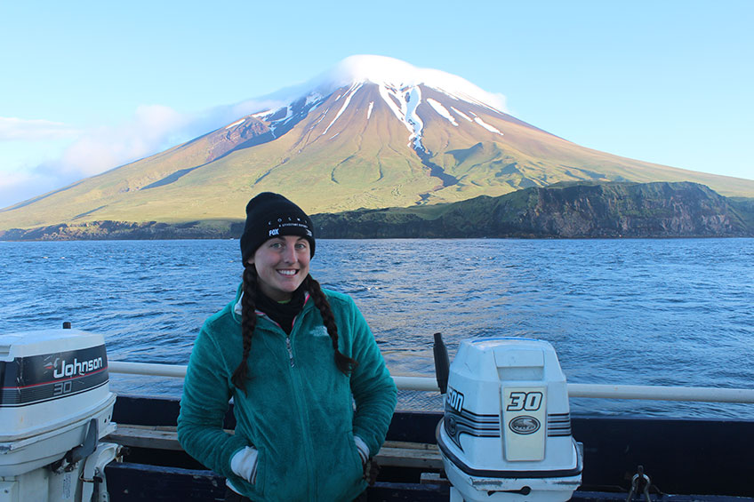 Bobbi Hornbeck during her fieldwork with Segula Volcano in the background, which is just one of the Aleutian Islands that her project takes place on.