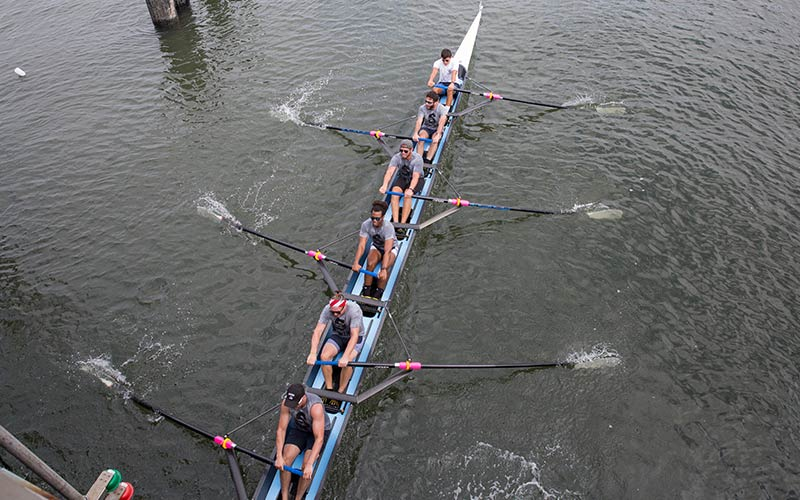 Men's rowing team on the water
