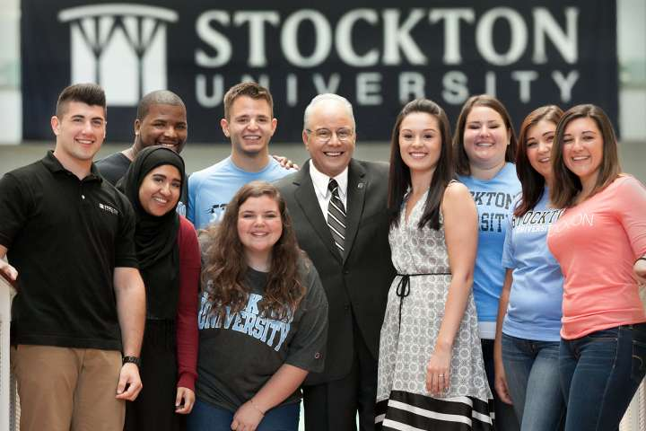 President Harvey Kesselman posing with Students