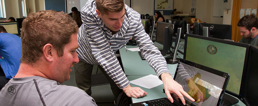 Image of students working planning software in computer lab