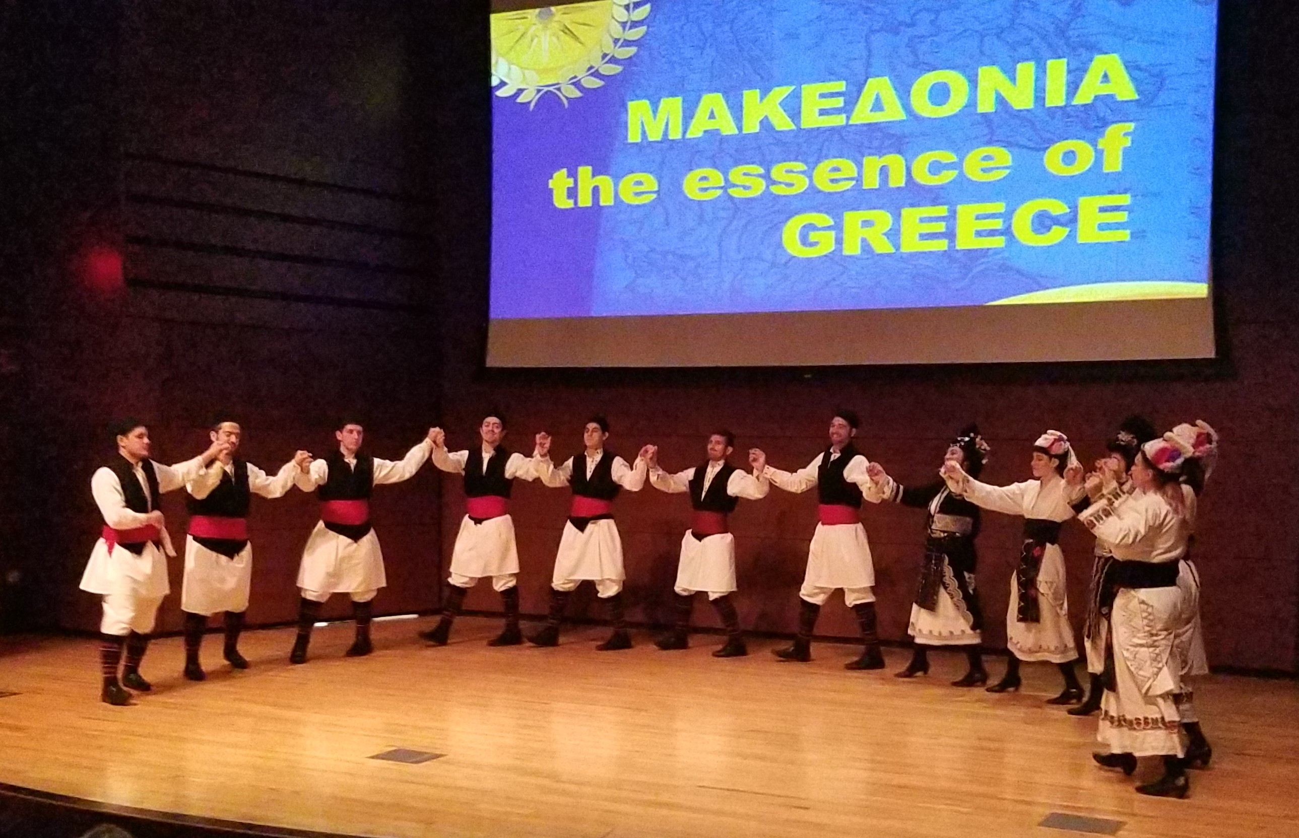 The Macedonian Dancers of Philadelphia perform on the Campus Center Theatre stage.