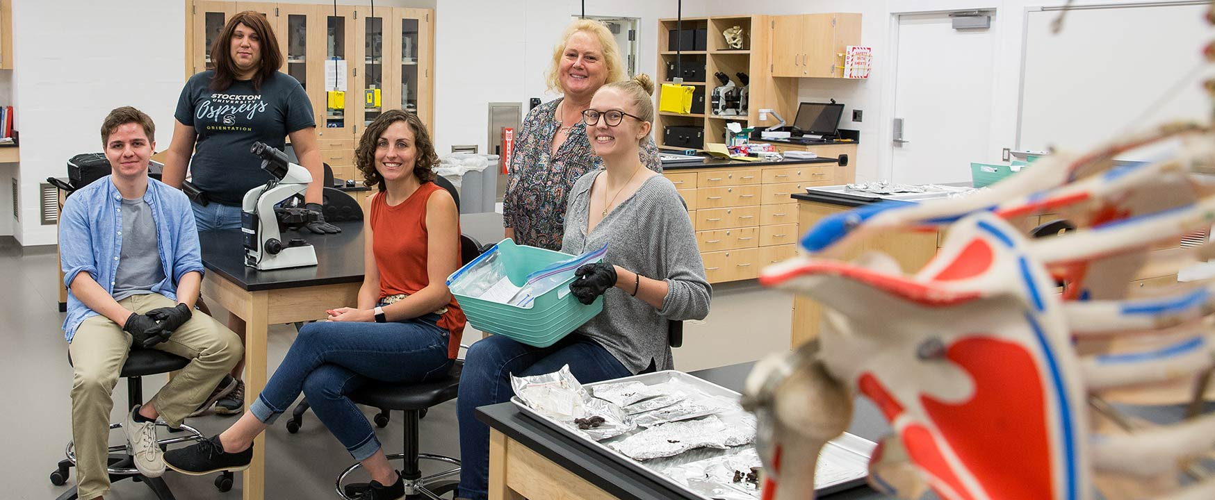 From left, Joseph Ross, Jennifer Rios, Professor Hornbeck, Anne LoDico and Carly Hammartstrom take a break from sifting through samples Hornbeck collected in the western Aleutian Islands of Alaska.