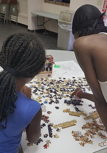 two students work on a puzzle