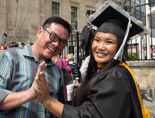 AtlantiCare OR Nurse Warren Flores congratulates his daughter, Charisse Flores, on receiving her nursing degree from Stockton University at the Boardwalk Hall ceremony on May 12.