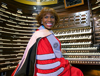 Beverly Vaughn, professor of Music, at the organ at Boardwalk Hall during Stockton's Commencement ceremony on May 12.