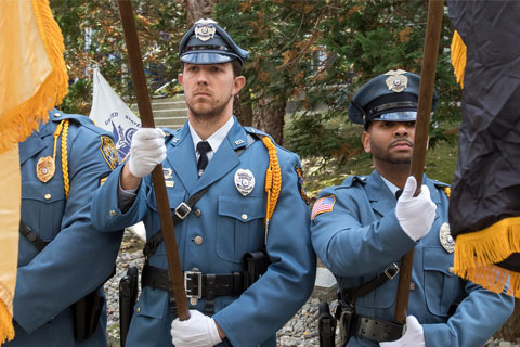 officers holding flags